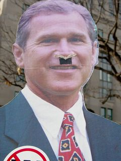 As has become a staple at many of these kinds of marches, likenesses of George W. Bush come out. This one showed Bush with a Hitler mustache, a substance that's supposed to resemble cocaine on his nose, and a big wad of cash penned into his hand.
