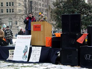 At McPherson Square, sound equipment and a stage had been set up and musicians were playing, with left.org as the primary sponsor.