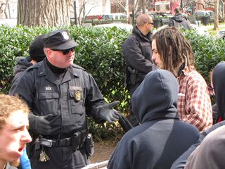 Park Police Officer Beck and MPDC Captain Jeff Herold try to explain why we can't stay in the park.