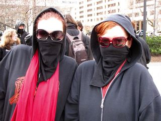 """Say """"cheese""""! I really did love the big movie star sunglasses that these two were sporting for our march. With the large-sized shades, their black bloc anonymity was complete."""