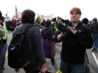 While we waited, and even after we got going, this gentleman with red hair proceeded to make a large nuisance of himself, aggressively asking loaded questions to some of the participants in our black bloc.
