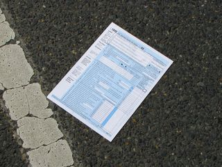 Someone had also scattered copies of IRS Form 1040 on the ground along the early part of the march route.