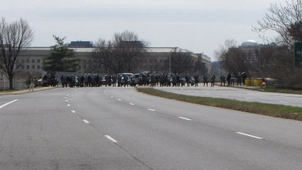 At the site of the previous standoff, and perhaps anticipating another standoff, police were already lined up at the north end of the bridge ready to block further progress south should the barrier fail.