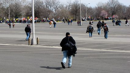 A number of people took a shortcut across the parking lot to gain some ground rather than following the established march route, which squared off a corner of the parking lot.