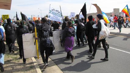 The march continues through the Pentagon's parking lots along Boundary Channel Drive.