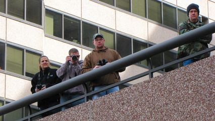 From a balcony along our march route, a number of non-participants took a moment to watch our march pass by.