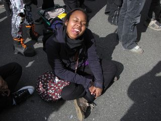 After having been marching more or less continuously for more than eight miles, the group that had originally gathered for the black bloc leaving from Farragut Square finally got a chance to sit down and chill out for a while.