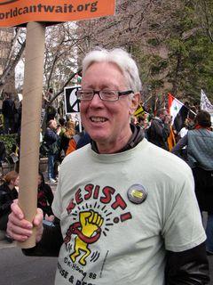 Former DAWN activist David Barrows, holding a World Can't Wait sign.