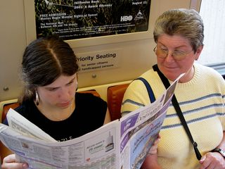 Once aboard the train (Breda 3285), Sis broke out the McPaper, while Mom also got a peek at some stories. Next station: Farragut West.
