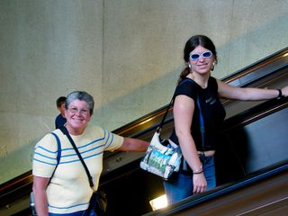 Leaving Metro Center, Mom and Sis flashed big smiles for the camera.