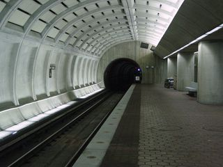 Out of the tunnel and into the station, this is the Greenbelt-bound side of the tracks.