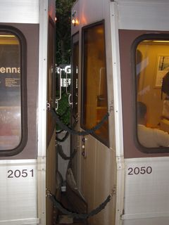 """And finally, before going home, a peek between Breda 2050 and 2051, to see the """"blind"""" ends of a pair of Breda cars. On the way home, Sis took a nice, long nap."""
