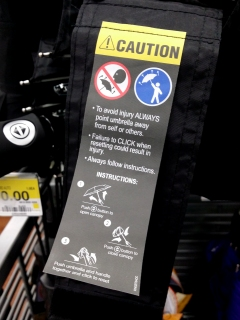 I had to replace my umbrella on April 14 after I lost my old one, and I was surprised to see this label on the new one. I always figured that it was a given that you shouldn't open the umbrella with the business end pointed towards you, but I guess not everyone knows that...