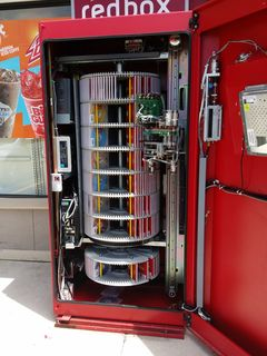 On May 20, I stopped at the 7-Eleven in Aspen Hill and spotted the Redbox movie rental kiosk open and being serviced. I suppose I never gave much thought to what the inside of a Redbox looked like prior to this, but this is what it looks like.