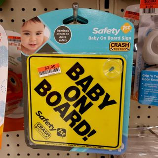 """I spotted these """"BABY ON BOARD"""" signs at the Big Lots store in Lutherville. I find these signs to be obnoxious. The intent of these signs is to warn drivers to be a little more careful around their vehicle because of the presence of a small child inside. There's another variant that says """"BABY ON BOARD - KEEP DISTANCE""""."""
