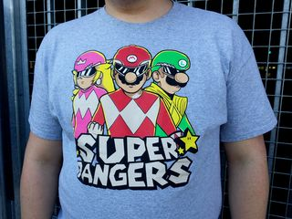I spotted this shirt at College Park station on August 3. I thought it was pretty awesome, mixing Power Rangers and Super Mario. A little research revealed that this shirt was designed for the July 2015 1Up Box shipment, and therefore is not sold in stores.