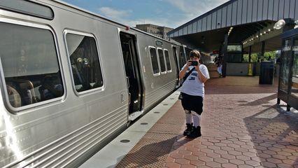 Elyse photographs a 7000-Series train at King Street.