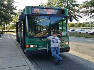 Elyse poses for a photo with bus 9521, a Gillig Low Floor. This is a former Howard Transit bus. Howard Transit is one of the predecessor entities to RTA, which was formed as a consolidation of several smaller local agencies.