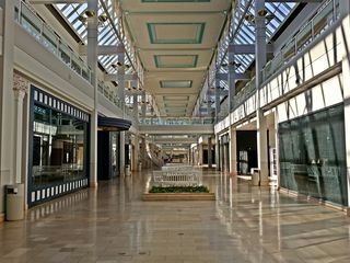 """On September 11, Elyse and I visited Owings Mills Mall, a large two-story mall outside Baltimore. The mall was a """"dead mall"""" in just about every way. At the time of our visit, the mall only had six stores remaining: Bath & Body Works, DTLR, Gymboree, JCPenney, Macy's, and Victoria's Secret. The interior of the mall would close before the month was over."""