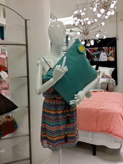"""On September 12, I had a moment of great immaturity with a mannequin at the JCPenney in Wheaton. Yes, that mannequin is doing exactly what you think it's doing, and it serves them right for getting mannequins with articulated, posable fingers in the first place. I caption this photo, """"F--- you, this is my pillow."""" The simple gesture reminded me of that cartoon that goes, """"Everyone just wants to be liked and accepted. Except for Tim."""""""