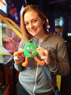 On November 11, I got together with Melissa, and we went up to Dave and Buster's at Arundel Mills. She won this little apple plush in a claw machine. She ended up giving it to Elyse.