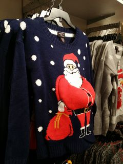 Melissa and I also spotted this sweater while we were out. No one can say that Santa Claus is a flat character here. Yes, Santa is stuffed on the front of this sweater...