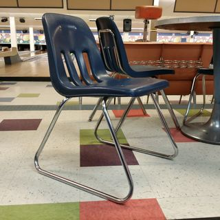While at the bowling alley, one of the things that I noticed was the Virco sled-base chairs. Those brought me back to my middle school days, as they ordered a bunch of these when they enlarged the building in 1993. However, unlike these, which use the sled base directly on the floor, the chairs at my old middle school were retrofitted with floor runners to prevent tile damage.