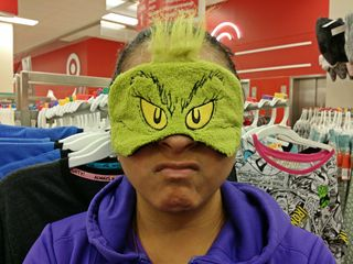 On December 2, after a swimming session, my friend Suzie and I went to the Target in Rockville. Here, Suzie is posing with a Grinch sleep mask - first making a grinchlike face, and then making a happier face.