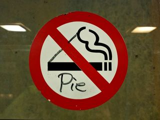 """On December 6, in the elevator at the Rockville Metro station, I spotted this. """"No smoking"""" is transformed to """"no pie""""."""