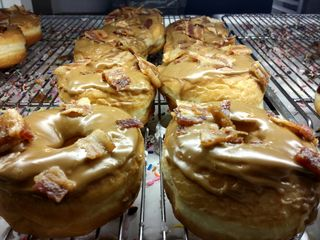 All of us swung by a local donut shop for dessert after dinner, and I was quite surprised to find these in the case. These are maple and bacon donuts. I had one of these, and they were actually quite good.
