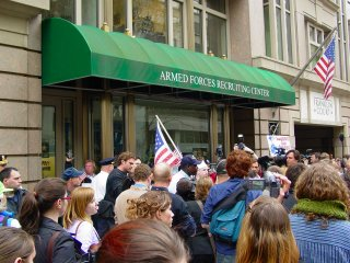 Arriving at the recruitment center, we found that pro-war counter-protesters were already demonstrating outside the recruitment center, and that police had lined up between the two groups.