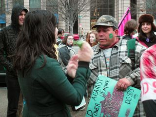 Samantha discusses things with the gentleman who lined up the march and started it going the wrong way.