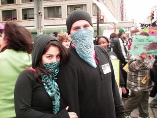 A masked couple poses for the camera.