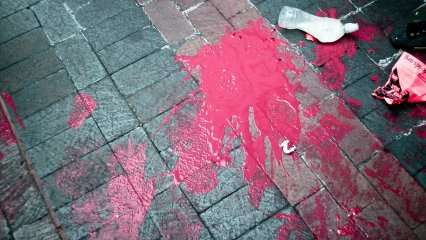 Another potential paint bomb filled with red paint did not make its target, having been smashed on the ground, with its contents splattered all over the sidewalk.