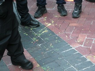 Yellow paint spattered on the sidewalk. I managed to catch a spot of this paint on my shoe, in fact.