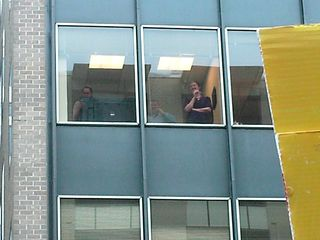 Office workers watch us demonstrate from their building. We, meanwhile, urged them to come out and join us. After all, I took the day off from my office to protest the war - they should, too!