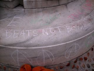 Chalk drawings on the fountain, and signage hung from the fountain.