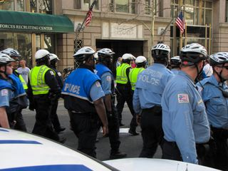 Police activity in the street after the demonstrators were moved to the sidewalk.