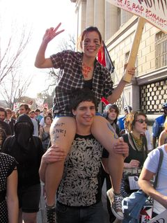 A woman gets up on a man's shoulders, specifically reproducing an action seen at Funk the War 8.