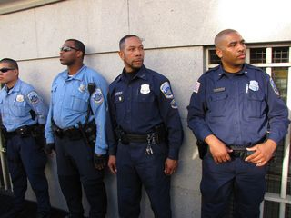 Meanwhile, MPDC officers guard the building, making sure no one else goes up and joins them.