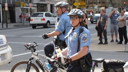 Cops were doing their darndest to keep us on the sidewalk and out of traffic.