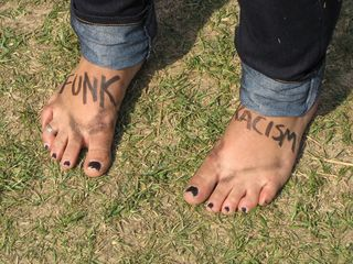 """One participant decorated her feet with the words """"FUNK RACISM""""."""
