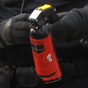 """Detail of the cans from the previous photo. Note that the safety pin is missing on at least one can (i.e. it was ready to fire), and note that """"MK-9"""" and a brand logo is readable on the can."""