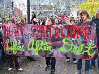 """Bury Capitalism: Life after Debt"" banner."