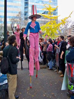 And the people on stilts are up and on their way!