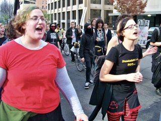 The march continues, with the radical cheerleaders and a small black bloc taking a spot near the front of the march.