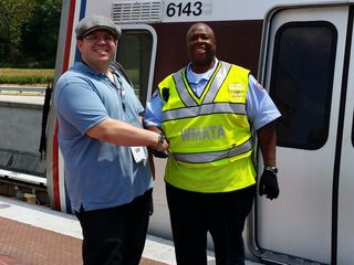 Photo with the operator of the first Silver Line train, 2014