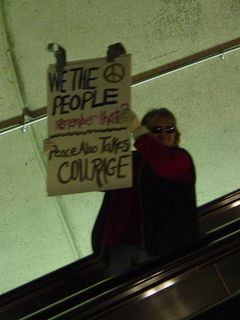 As I was leaving Rosslyn on the escalator, this group entered the Metro carrying protest signs.
