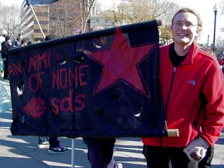 """""""An army of none"""" was one of the more visible signs throughout the day."""