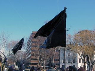 And as is the standard case with any black bloc, black flags were flying high. The one in the foreground was actually made out of a black garbage bag.